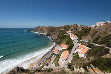 Elevated view of the Arrifana Beach in Aljezur, Algarve, Portugal. The beach of Praia da Arrifana is inside the Vicentine Coast Natural Park, an area of outstanding natural beauty.