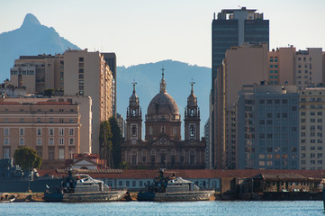 View of Rio de Janeiro Downtown With Candelaria Church, Marine Ships in Water, and Mountains in Background