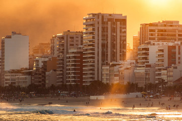 View of Apartment Buildings in Front of the Ipanema Beach by Sunset With Sun Beam Falling on Water
