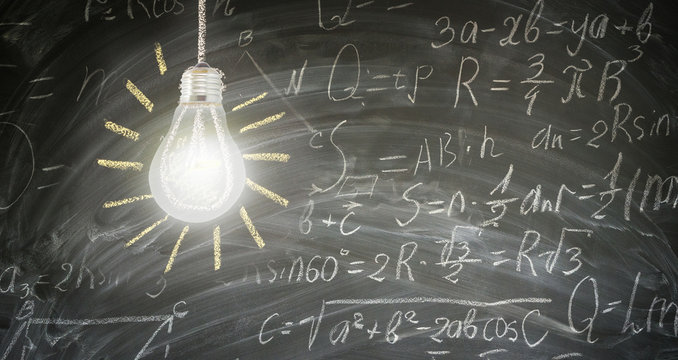 idea concept with bright glowing light bulb on blackboard with math formulas in background banner