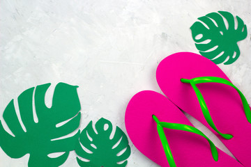top view pink slippers and paper monstera leaves copy space