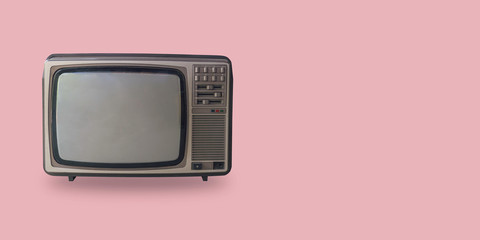 Retro television on pastel color background with space.