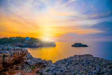 Amazing colorful sunrise scene over Punta Grossa coastline in Mallorca island of Spain