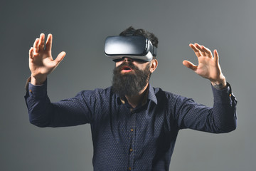 Amazed man in virtual reality headset. Future. Future technology concept. Bearded men using VR headset. Virtual reality goggles. Virtual reality device.