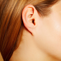 Woman's ear close up, anatomy concept