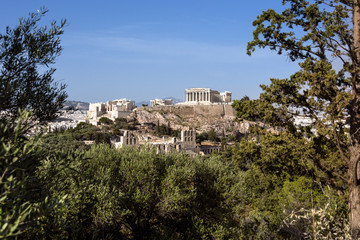 Greece, Athens: Panoramic skyline view of famous Acropolis with Parthenon, Erechtheum, Temple of Athena in the city center of the Greek capital and blue sky in the background - concept travel.