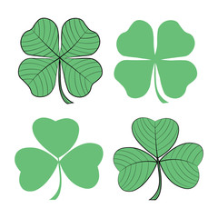 Set of clover hand drawn icons. St. Patrick's day symbols.
