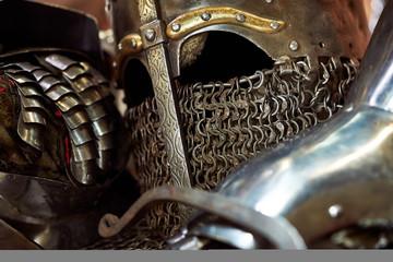 Medieval metal helmet and metal glove