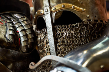 Medieval metal helmet and metal glove