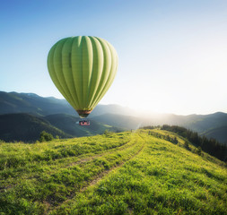 Air ballon above mountains at the summer time. Concept and idea of adventure