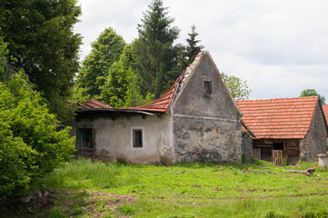 Old abandoned traditional village house. Collapsed roof.