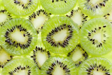 Slices kiwi fruit on white background
