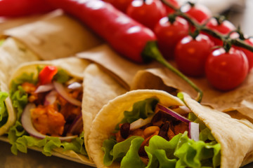 Mexican burrito with chicken, pepper and beans