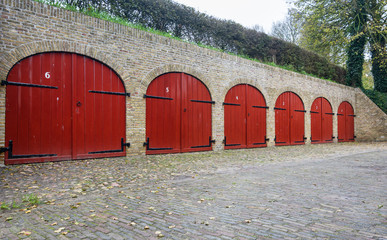 The red doors of the former depots of Bourtange, a Dutch fortified village in the province of Groningen