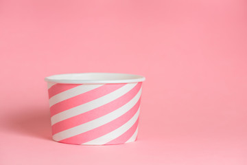 summer funny creative concept of empty blank paper cup over pastel pink background, copy space