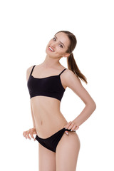 woman with perfect sporty body in black lingerie