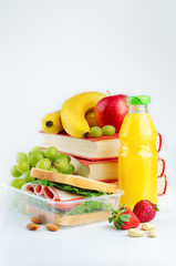 school lunch with a sandwich, fresh fruits and juice