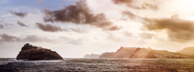 Rocky Atlantic shoreline under dramatic cloudscape. Sunrise on Cape Verde. View from the sea Wall mural