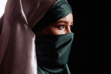 thoughtful Islamic lady. close up side view shot.