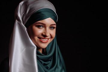 laughing Muslim girl in satin green hijab