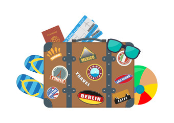 Vector illustration. Tourist suitcase with accessories for rest.
