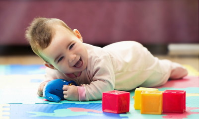 Sweet Smiling Baby Boy Crawling And Playing With Toys