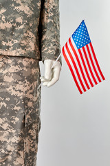 Mannequin in army uniform with usa flag. Patriotic soldier concept. White isolated background.