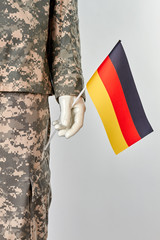 Mannequin in army uniform with deutsch flag. White isolated background.
