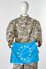 Mannequin soldier holding european flag. White isolated background.