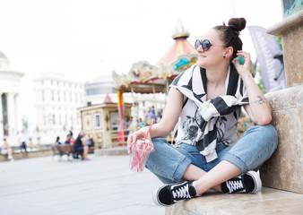 Young girl smiling at an amusement park