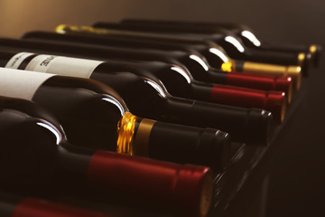 Autocollant pour porte Vin Bottles with delicious wine on shelf, closeup. Professional sommelier