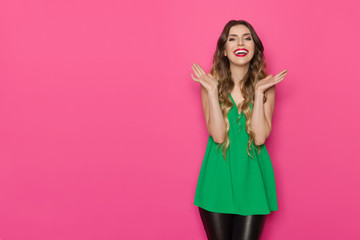 Excited Young Woman In Green Top Is Gesturing And Shouting