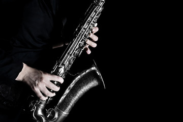 Printed kitchen splashbacks Music Saxophone player hands closeup. Saxophonist