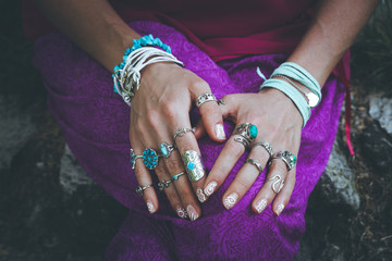 close up of young woman hands with boho accessories rings and bracelets