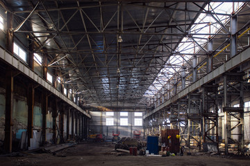 Abandoned rusted ruined industrial hall waiting for reconstruction. Former Voronezh excavator plant