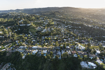 Aerial view of canyon and hillside homes above Beverly Hills and West Hollywood in Los Angeles California.