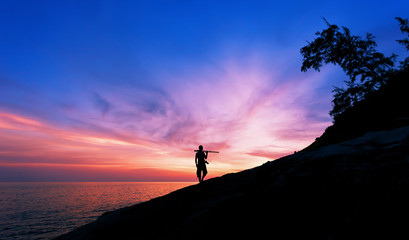 Professional photography on the stones in sunset or sunrise dramatic sky over the tropical sea in phuket thailand.