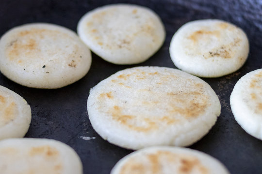 Cooking arepas in the pan