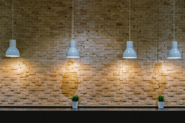 Mockup of the Light over the cafe interior bar table beside the wall with wooden style