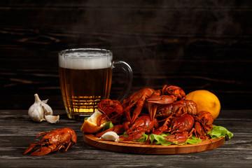 Hot boiled crawfish with a mug of beer