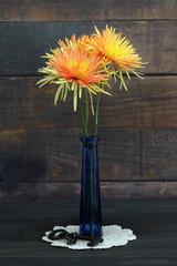 Orange and Yellow Spider Mum in vase.