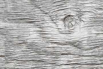 Background from gray painted wooden board with a knot. Closeup
