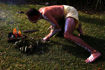 Aboriginal Terry Olsen prepares a fire before performing a smoking ceremony to mark the start of National Reconciliation Week for Aboriginal and Torres Strait Islanders in Sydney