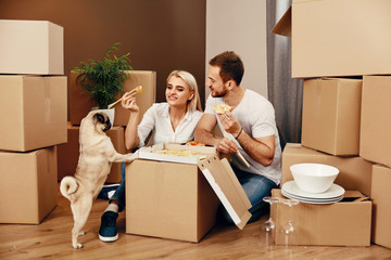 Moving. Man And Woman Eating Near Boxes