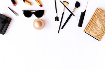 Professional decorative cosmetics and makeup brushes on white background. Flat lay. Top view.