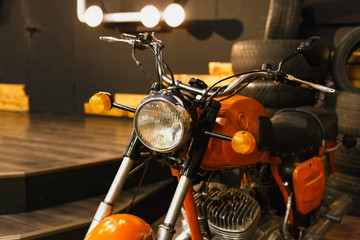 Vintage style, cafe-racer, motorcycle in garage.