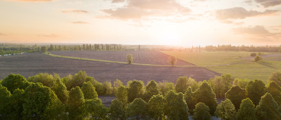 Wall Mural - Beautiful panorama of a field against a sky at sunset. Photo from the drone