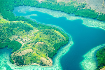 Aerial view of Busuanga island. Tropical lagoon with turquoise water, coral reef and white sand.