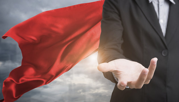 confident business superhero man wearing red cape against with city background. concept point to future.