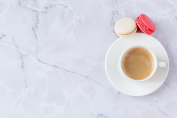 a cup of coffee with sweets on a gray marble background. Copy space. Selective focus.